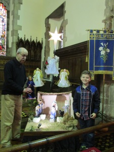 Grant Balmer and Dylan Bird add the Three Kings to the Nativity Scene at the Epiphany All-Age Worship service on Sunday 8th January 2017