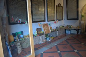 Display of harvest produce in the church porch