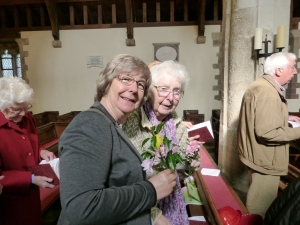 Some ladies in the congregation with their posies of Spring flowers