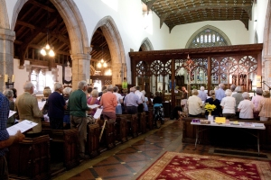 Stuart, the programme director for BBC Radio Wales brings in the congregation at Guilsfield Church during the radio recording