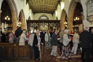 The congregation leaving the packed church after the celebration service