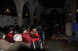 A packed St Aelhaiarn's in candle light awaiting the start of the Christmas Eve Carol Service