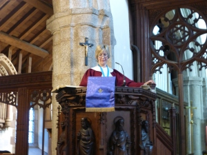 The Narrator standing in the pulpit sets the scene for each of the Scenes of the play