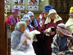 Mary is holding the baby Jesus watched by Joseph, the Kings and the Shepherds in the 'Inside the Stable' scene