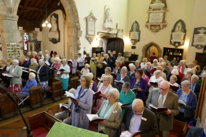 Congregation singing one of 17 hymns at the St Asaph Diocese MU 125th Anniversary Service at Guilsfield Church