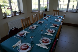 Table laid with starter awaiting guests