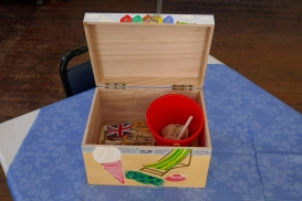 Seaside Holiday Memory Box open and showing contents, including bucket, flags and I-Spy book.